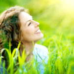 shutterstock_137699207-woman-smiling-in-the-sun-mar15